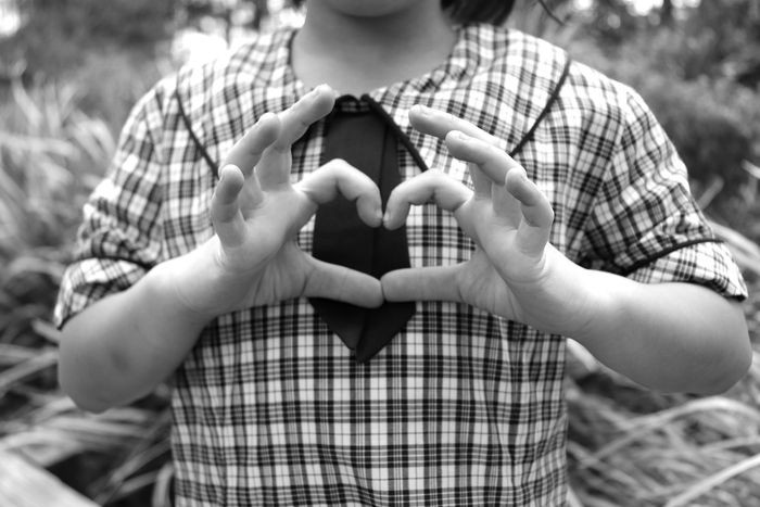 Student with hands in heart shape